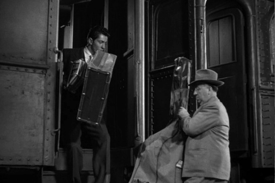 Still from Strangers on a Train. Farley Granger and Alfred Hitchcock.