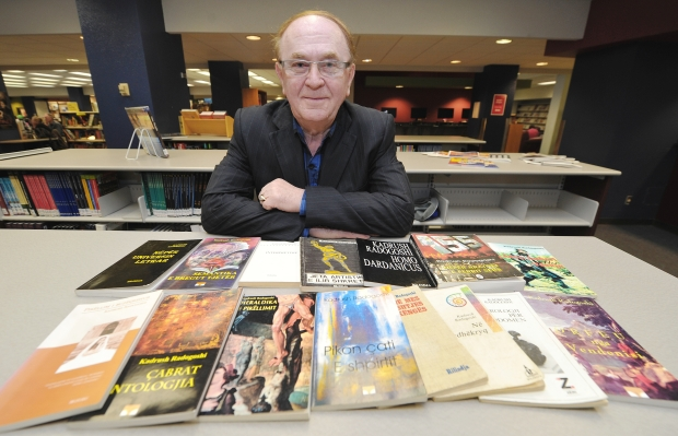 Kadrush Radogoshi, with his published works, at Norquest College, Edmonton (Courtesy: Edmonton Journal)