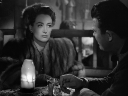 Joan Crawford, as Mildred Pierce, and Manitoba's Jack Carson as her business partner.