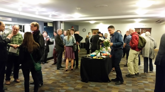 Post-concert reception at the Vancouver Playhouse. Mr. Lomovsky at far left, Mr. Arahonian at distant centre, Mr. Naidin in middle centre, Mr. Balshin (his back, anyway) at the buffet. 9 May 2015. (Photo: Hendrik Slegtenhorst)