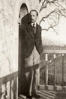 Rilke at the balcony on Muzot, 1923. (Courtesy:  Schweizerisches Literaturarchiv, SLA, Bern)